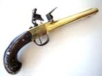 click to view detailed description of A Magnificent Brass Double Barreled Flintlock Pistol with Silver Inlays by John Parkes of London circa 1770.