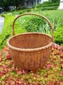 click to view detailed description of A very fine NANTUCKET swing handle basket made circa 1880.