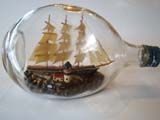 click to view detailed description of A vintage three-masted ship in a Haig Whiskey bottle circa 1940