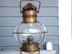 click to view detailed description of A British Admiralty Lamp by Davies of London circa 1900