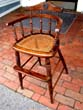 click to view detailed description of A charming19th century childs high chair with rattan seat circa 1860-1890