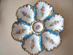 click to view detailed description of An extremely beautiful hand painted vintage Limoges oyster plate circa 1900