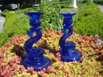 click to view detailed description of A gorgeous pair of cobalt blue dolphin form candlesticks