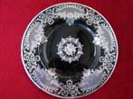 click to view detailed description of A beautiful vintage black glass serving plate with fabulous silver overlay circa 1910