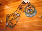click to view detailed description of A late 19th century European wrought iron hanging sign from a railroad station