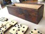 click to view detailed description of A fine set of Civil War era bone and ebony dominoes circa 1865
