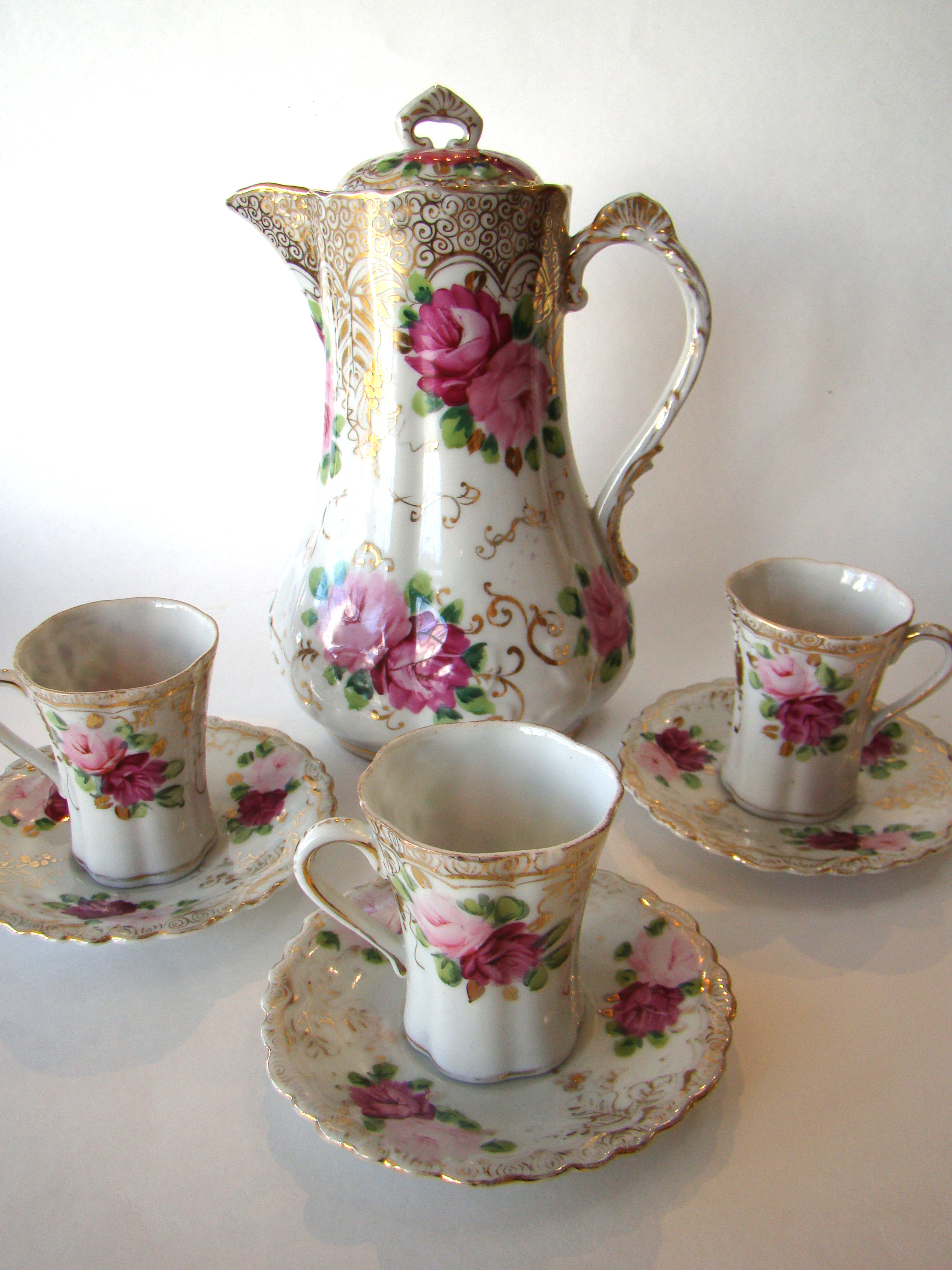 click to view detailed description of A beautiful vintage Japanese bone china chocolate pot with three matching cups and saucers circa 1890-1900