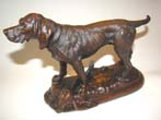 click to view detailed description of A fine late 19th century solid bronze sculpture of a hunting dog with his pheasant