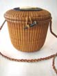 click to view detailed description of One of the finest and earliest signed Jose Reyes Nantucket Friendship basket in the cocktail size circa 1947-1948