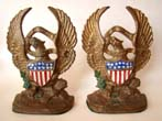 click to view detailed description of A pair painted cast iron American eagle bookends by Hubley Mfg. circa 1928