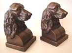 click to view detailed description of A charming pair of Cocker Spaniel bookends by Jennings Brothers circa 1930