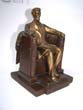 click to view detailed description of A Single Antique Bookend circa 1950 depicting Abraham Lincoln 'sitting in the chair' at the Lincoln Memorial.