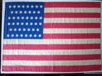 click to view detailed description of A 46 star American flag made of silk dating to 1907-1912