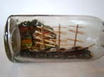 click to view detailed description of A late 19th or early 20th century ship in a bottle