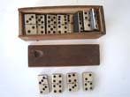click to view detailed description of An early 19th century complete set of bone and ebony dominoes