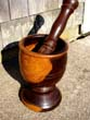 click to view detailed description of A beautiful early 19th century Mortar & Pestle made of highly figured lignum vitae