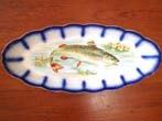 click to view detailed description of An attractive late 19th century hand painted fish serving platter