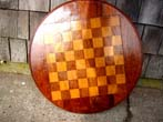 click to view detailed description of A beautiful antique fruitwood inlaid double side games board for chess, checkers, backgammon and cribbage circa 1890