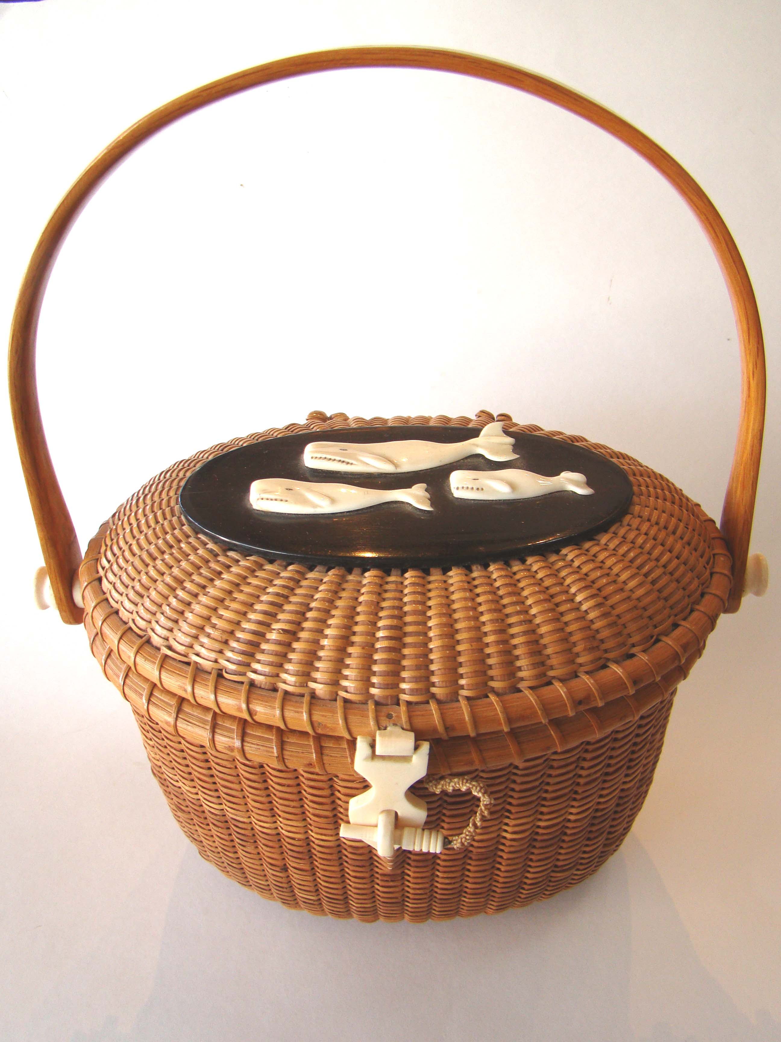 click to view detailed description of An exceptionally fine and important Nantucket covered basket purse made by the iconic basket maker Gladys Ellis circa 1970.