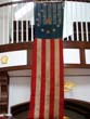 click to view detailed description of A late 19th century U S Thirteen Star Ships Banner