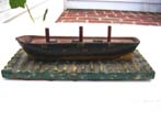 click to view detailed description of A charming miniature 19th century carved wooden sailing ship at drydock, the underside of base with five whaling log book stamps.