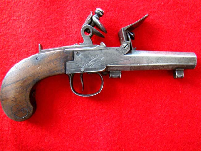 click to view detailed description of A flintlock .50 cal. pocket pistol, Belgian or French, circa 1785