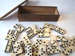 click to view detailed description of An outstanding set of hand cut Civil War era bone & ebony dominoes in their original box circa 1860