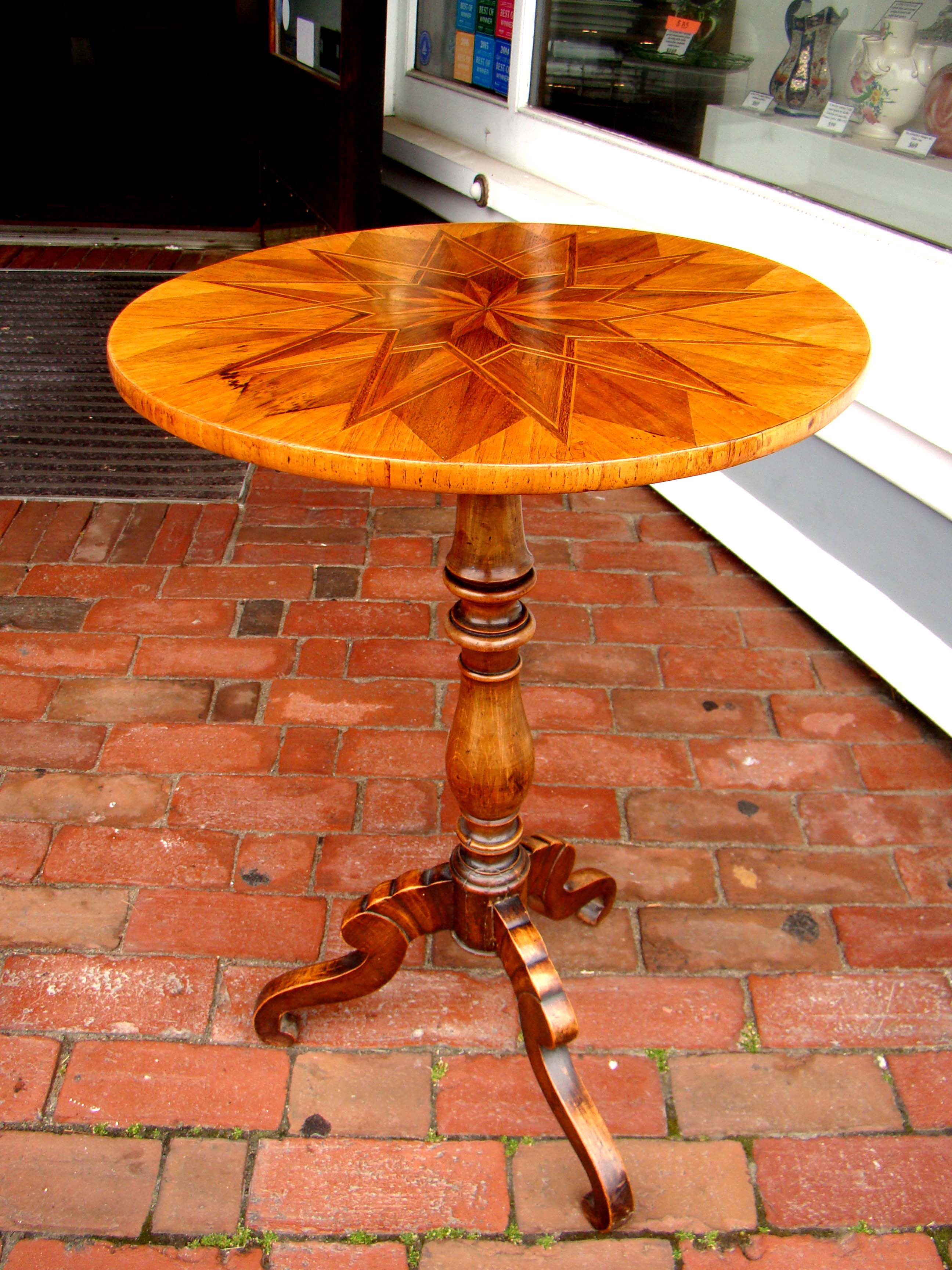 click to view detailed description of A gorgeous English parquetry fruitwood inlaid walnut  tripod table circa 1830