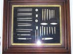 click to view detailed description of A framed grouping of 34 Whalebone Sewing Implements from the 19th century