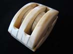 click to view detailed description of A fabulous sailor-made whale ivory double block circa 1850