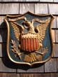 click to view detailed description of A fine relief carved American eagle plaque called the