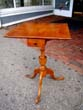 click to view detailed description of A diminutive 18th century New England Tiger Maple one-drawer stand