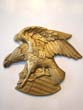 click to view detailed description of A cast plaster American eagle plaque by Miller Studios 1969