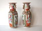 click to view detailed description of A pair of late 19th century Chinese Export porcelain Rose Medallion vases