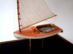 click to view detailed description of A highly detailed scale model of a 1923 Beetle Catboat made by Cape Cod model boat builder Tom Lauria