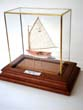 click to view detailed description of A fabulous miniature scale model of a circa 1921 BEETLE CATBOAT