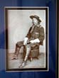 click to view detailed description of A framed photo of Maj. Gen. George Armstrong Custer taken in March 1865