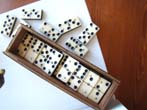 click to view detailed description of A boxed set of 28 bone and ebony dominoes from the Civil War period circa 1865