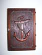 click to view detailed description of A Wooden Memorial Book with carved Anchor on the front and a carving of the ship EURYDICE on the back. The brass clasp is engraved Relic of the Eurydice, Lost March 24, 1878.