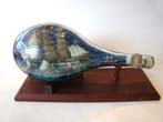 click to view detailed description of A fabulous late 19th or early 20th century Ship-in-a bottle diorama