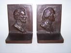 click to view detailed description of An exceptionally fine pair of solid bronze Antique Bookends circa 1915 depicting Washington and Lincoln.