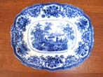 click to view detailed description of A fine early 19th century flow blue serving platter by William Adams& Co., circa 1820