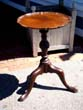 click to view detailed description of A beautiful small George III mahogany piecrust tripod table circa 1760