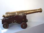 click to view detailed description of A late 19th or early 20th century model of a War of 1812 period naval cannon