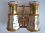 click to view detailed description of A beautiful pair of late 19th century French opera glasses by Lemaire of Paris