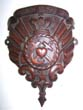 click to view detailed description of A 19th century Carved Wooden Shield with the words