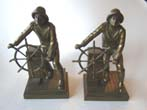 click to view detailed description of A pair of GLOUCESTER FISHERMAN Memorial bookends by Jennings Brothers circa 1930.