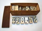 click to view detailed description of A complete set of 28 Civil War era bone and ebony dominoes circa 1865