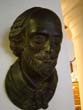click to view detailed description of An attractive late 19th century plaster bust of William Shakespeare