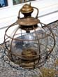 click to view detailed description of An extremely RARE large American ships five burner whale oil mast head lantern circa 1851